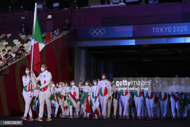 Flag bearers Jessica Rossi and Elia Viviani of Team Italy lead their team during the Opening Ceremony of the Tokyo 2020 Olympic Games at Olympic...
