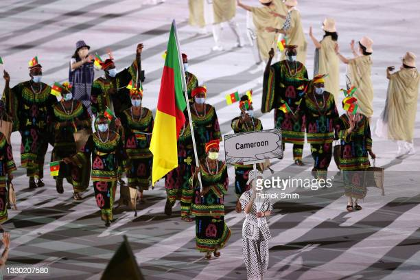 Flag bearers Joseph Emilienne Essombe Tiako and Albert Mengue Ayissi of Team Cameroon during the Opening Ceremony of the Tokyo 2020 Olympic Games at...