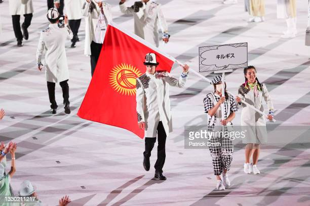 Flag bearers Kanykei Kubanychbekova and Denis Petrashov of Team Kyrgyzstan during the Opening Ceremony of the Tokyo 2020 Olympic Games at Olympic...