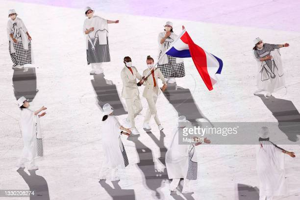 Flag bearers Keet Oldenbeuving and Churandy Martina of Team Netherlands during the Opening Ceremony of the Tokyo 2020 Olympic Games at Olympic...