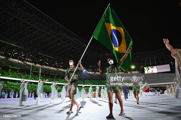 Flag bearers Ketleyn Quadros and Bruno Mossa Rezende of Team Brazil lead their team out during the Opening Ceremony of the Tokyo 2020 Olympic Games...