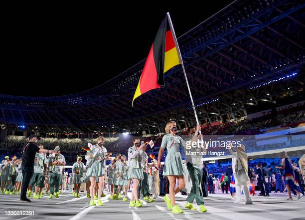 Flag bearers Laura Ludwig and Patrick Hausding of Team Germany leads their team out during the Opening Ceremony of the Tokyo 2020 Olympic Games at...