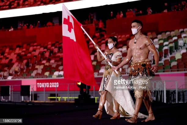Flag bearers Malia Paseka and Pita Taufatofua of Team Tonga lead their team during the Opening Ceremony of the Tokyo 2020 Olympic Games at Olympic...
