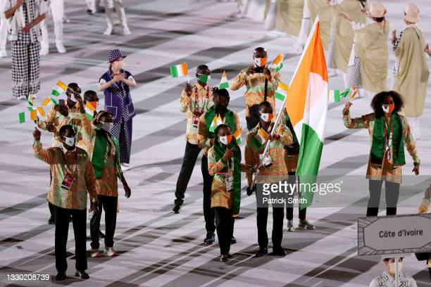 Flag bearers Marie-Josee Ta Lou and Cheick Sallah Cisse of Team Ivory Coast lead their team during the Opening Ceremony of the Tokyo 2020 Olympic...