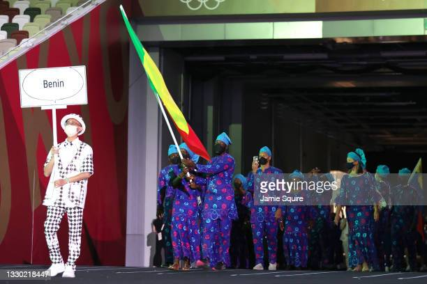 Flag bearers Nafissath Radji and Privel Hinkati of Team Benin during the Opening Ceremony of the Tokyo 2020 Olympic Games at Olympic Stadium on July...