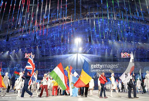 Flag bearers parade ahead of athletes during the Closing Ceremony of the Sochi Winter Olympics at the Fisht Olympic Stadium on February 23 2014 AFP...