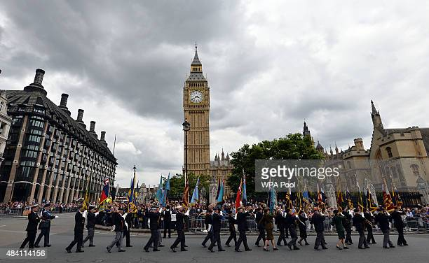 Flag bearers pass through Parliament Square as they take part in a parade from Horse Guards Parade to Westminster Abbey after a service of...
