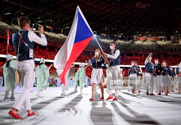 Flag bearers Petra Kvitova and Tomas Satoransky of Team Czech Republic lead their team out during the Opening Ceremony of the Tokyo 2020 Olympic...
