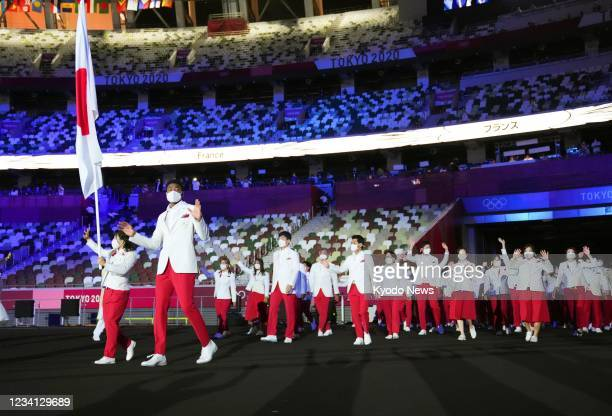 Flag bearers Rui Hachimura and Yui Susaki of Japan lead the team entering the National Stadium during the opening ceremony of the Tokyo Olympics on...