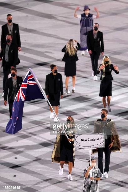 Flag bearers Sarah Hirini and David Nyika of Team New Zealand lead their team out during the Opening Ceremony of the Tokyo 2020 Olympic Games at...
