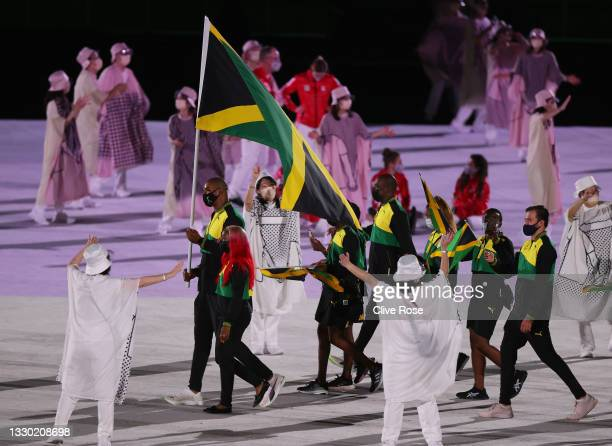 Flag bearers Shelly-Ann Fraser-Pryce and Ricardo Brown of Team Jamaica lead their team in during the Opening Ceremony of the Tokyo 2020 Olympic Games...