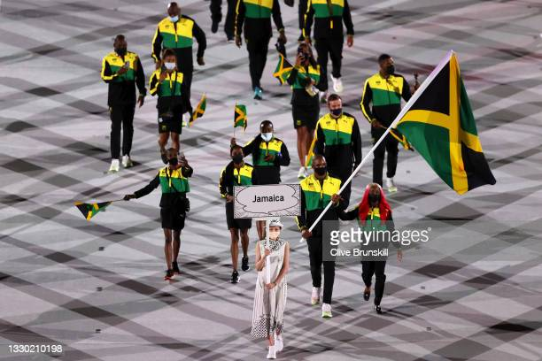 Flag bearers Shelly-Ann Fraser-Pryce and Ricardo Brown of Team Jamaica leads their team in during the Opening Ceremony of the Tokyo 2020 Olympic...