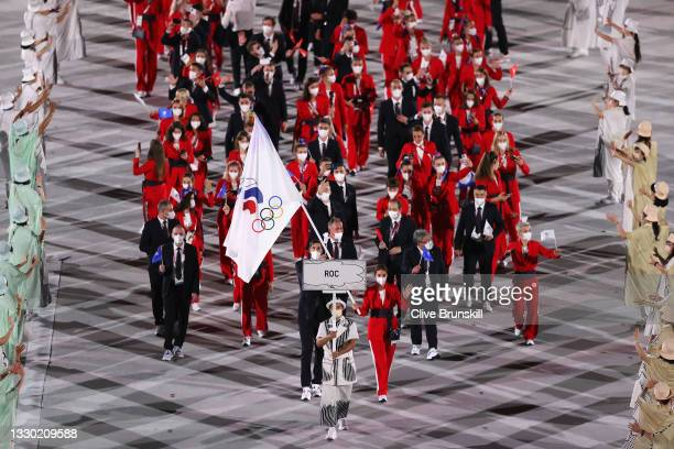 Flag bearers Sofya Velikaya and Maxim Mikhaylov of Team ROC lead their team in during the Opening Ceremony of the Tokyo 2020 Olympic Games at Olympic...