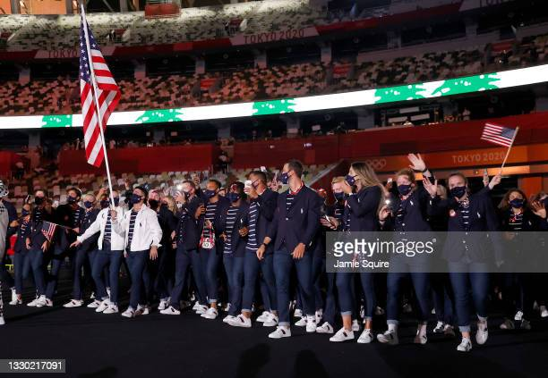 Flag bearers Sue Bird and Eddy Alvarez of Team United States lead their team out during the Opening Ceremony of the Tokyo 2020 Olympic Games at...