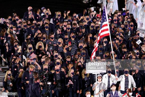Flag bearers Sue Bird and Eddy Alvarez of Team United States lead their team during the Opening Ceremony of the Tokyo 2020 Olympic Games at Olympic...
