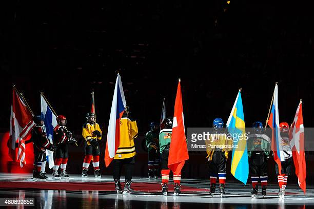Flag bearers take to the ice during the pre game ceremony during the 2015 IIHF World Junior Hockey Championship game between Team Slovakia and Team...