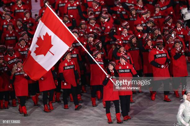 Flag bearers Tessa Virtue and Scott Moir of Canada leads the team during the Opening Ceremony of the PyeongChang 2018 Winter Olympic Games at...