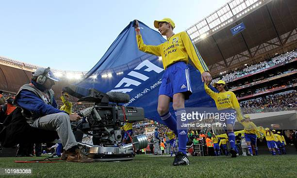 FIFA flag bearers walk into the stadium prior to the Opening Ceremony ahead of the 2010 FIFA World Cup South Africa Group A match between South...