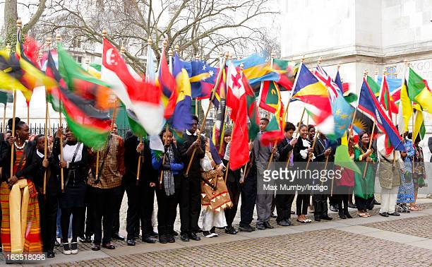 Flag bearers wave the flags of The Commonwealth outside Westminster Abbey after The Commonwealth Day Observance on March 11 2013 in London England...