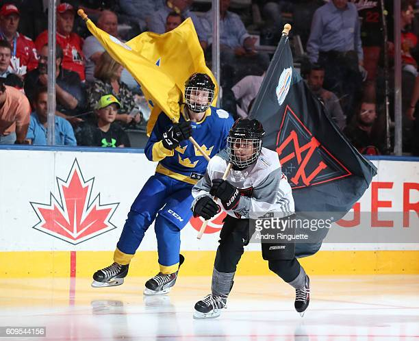 Flag bearers welcome Team North America prior to the game against Team Sweden during the World Cup of Hockey 2016 at Air Canada Centre on September...