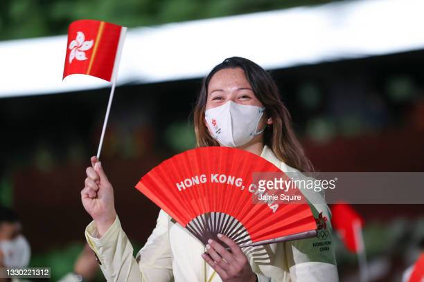 Flag bearers Ying Suet Tse and Ka Long Cheung of Team Hong Kong lead their team during the Opening Ceremony of the Tokyo 2020 Olympic Games at...