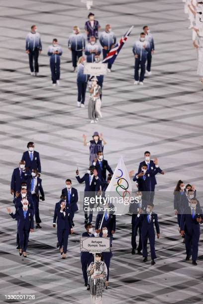 Flag bearers Yusra Mardini and Tachlowini Gabriyesos of The Refugee Olympic Team lead their team in during the Opening Ceremony of the Tokyo 2020...