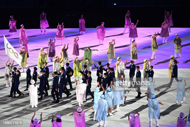 Flag bearers Yusra Mardini and Tachlowini Gabriyesos of The Refugee Olympic Team lead their team during the Opening Ceremony of the Tokyo 2020...