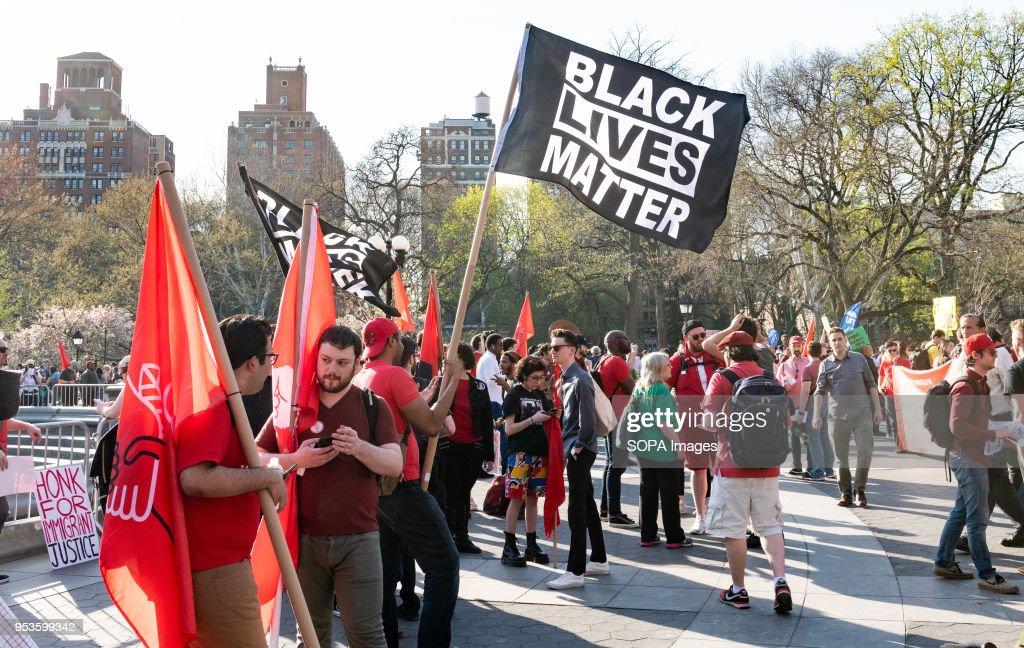 A flag bearing the slogan 'Black Lives Matter' seen during a... : News Photo