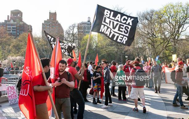 A flag bearing the slogan 'Black Lives Matter' seen during a May Day demonstration Union members activists and protesters protest on May Day at...
