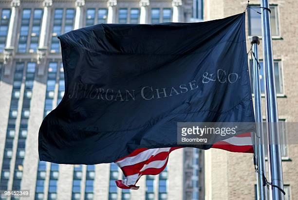 A flag bears the logo of JPMorgan Chase Co in New York US on Wednesday April 14 2010 JPMorgan Chase Co the second biggest US bank by assets beat...