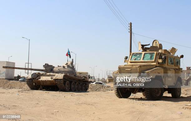 A flag belonging to fighters from the separatist Southern Transitional Council is seen on top of a tank in Aden's northern Dar Saad district as they...