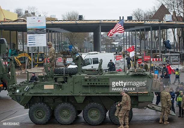 A US flag blows at a tank in front of an EstonianRussian border point during a military parade to celebrate 97 years since first achieving...