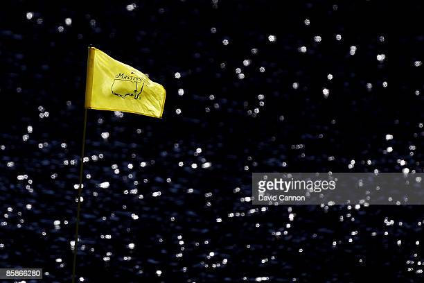 A flag blows in the breeze along the water during the Par 3 Contest prior to the 2009 Masters Tournament at Augusta National Golf Club on April 8...