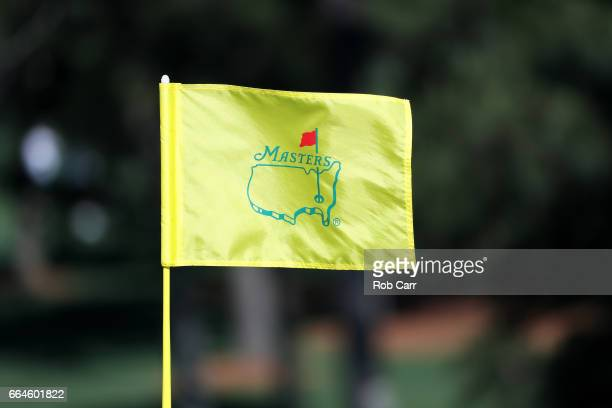 A flag blows in the breeze during a practice round prior to the start of the 2017 Masters Tournament at Augusta National Golf Club on April 4 2017 in...