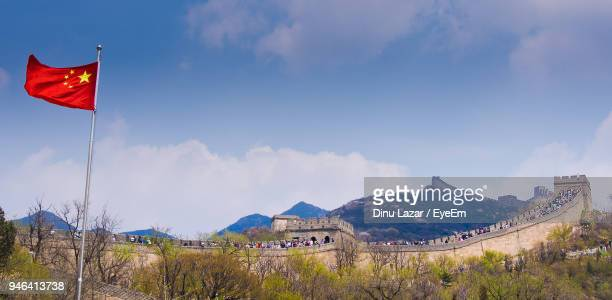 Flag By Great Wall Of China Against Sky
