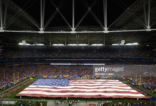 USA flag covers the field during the National Anthem for the 2007 Tostitos BCS National Championship Game between the Florida Gators and the Ohio...