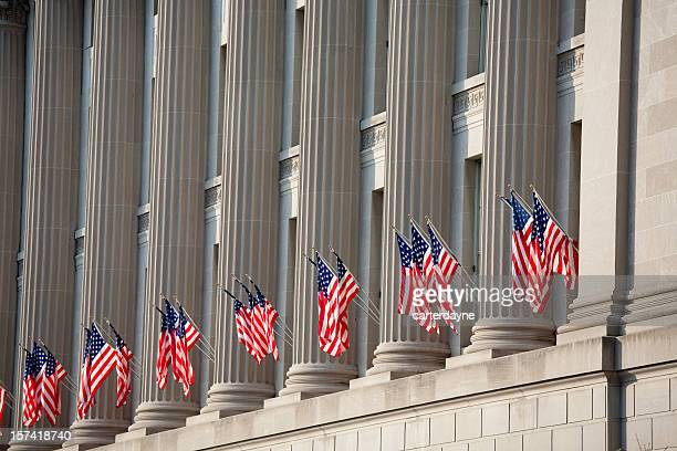 us flag decorations between columns for obama's swearing in - federal building stock pictures, royalty-free photos & images