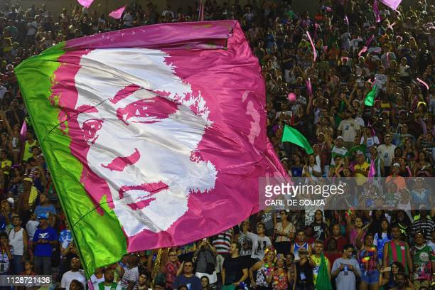 TOPSHOT A flag depicting the image of murdered council woman Marielle Franco is seen during the second night of Rio's Carnival parade at the...