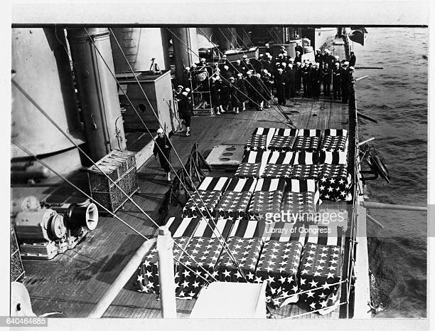 Flag draped coffins rest on the deck of the USS Montana with Navy sailors watching on the side The United States invaded Veracruz in 1914 in an...