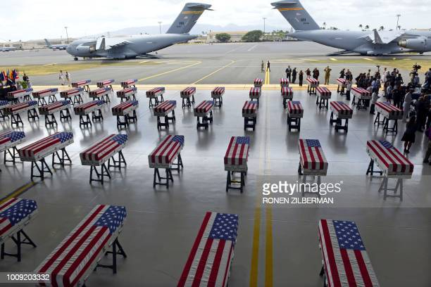 TOPSHOT Flag draped transfer cases with the remains of American soldiers repatriated from North Korea are seen during a repatriation ceremony after...