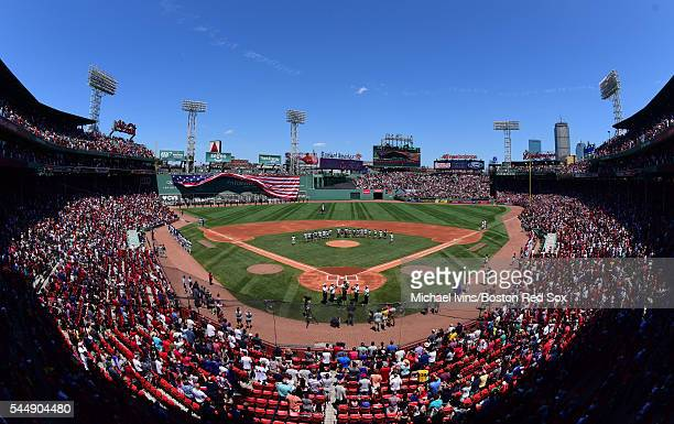 A flag drops over the left field wall before the start of a game between the Boston Red Sox and the Texas Rangers on July 4 2016 at Fenway Park in...