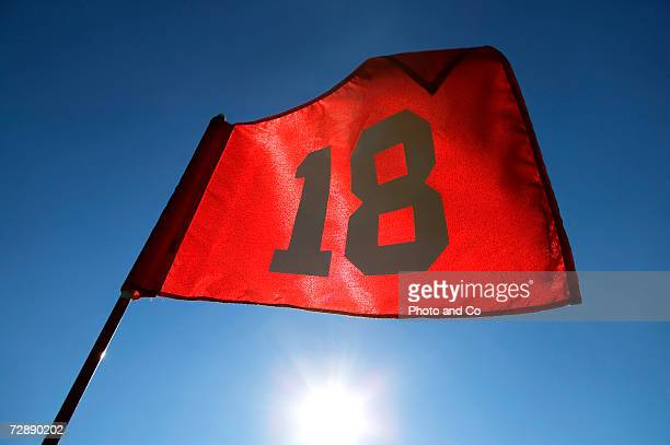 flag eighteen at golf course, close-up, low angle view - golf flag stock pictures, royalty-free photos & images