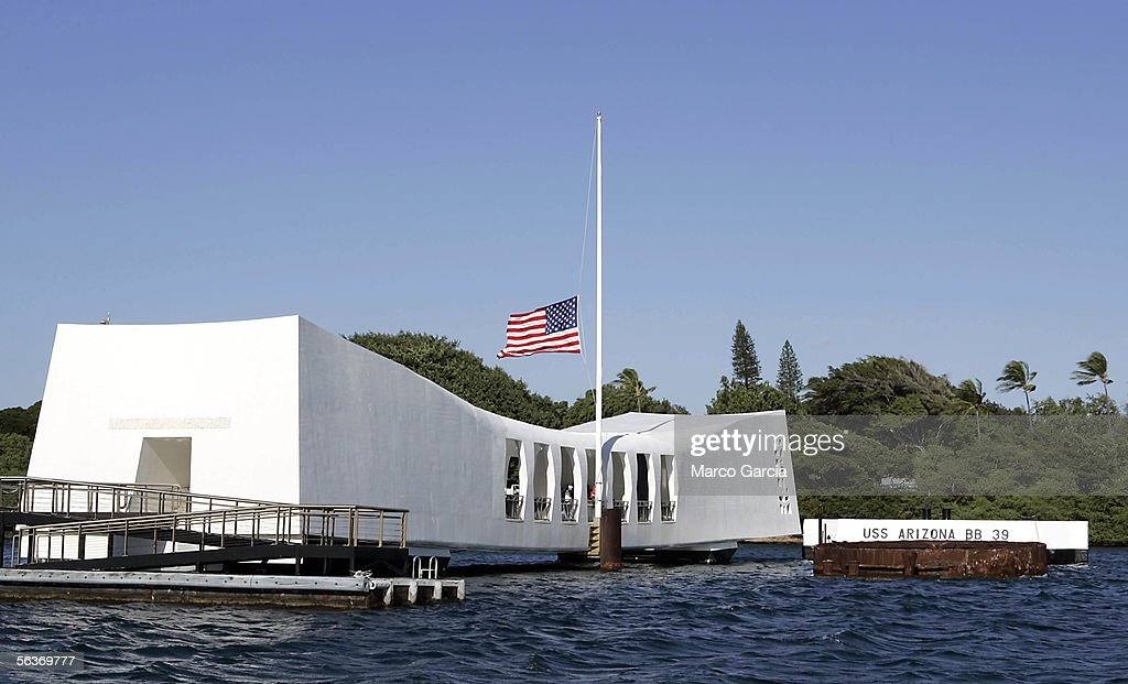S. flag flies at half mast aboard the USS Arizona Memorial during the ceremony honoring the 64th anniversary of the surprise attack on Pearl Harbor, December 7, 2005 at Pearl Harbor, Hawaii. Around the country, Pearl Harbor survivors and others paid tribute to those lost during the December 7, 1941 Japanese bombing of Pearl Harbor.