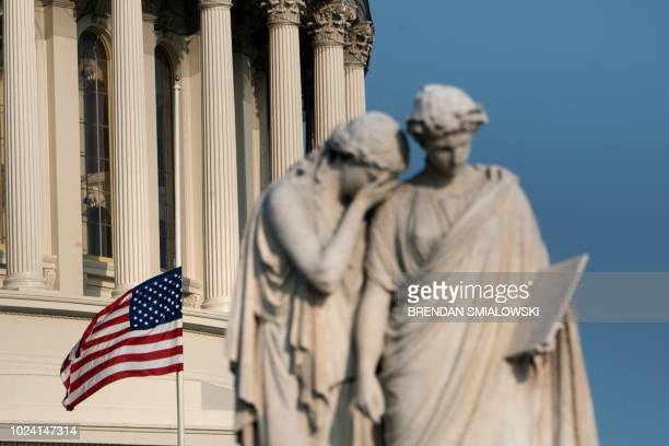 A flag flies at half mast at the Capitol US dome in honor of the late US Senator John McCain August 26 2018 in Washington DC McCain died on Saturday...
