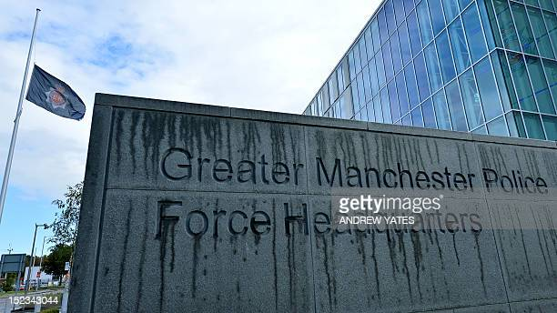 A flag flies at half mast at the headquaters of Greater Manchester Police in Manchester northwest England to pay respect to two female police...