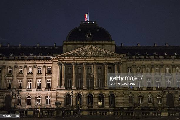 Flag flies at half mast at the Royal Palace on December 5, 2014 in Brussels after the palace announced that Belgium's former queen Fabiola, the...