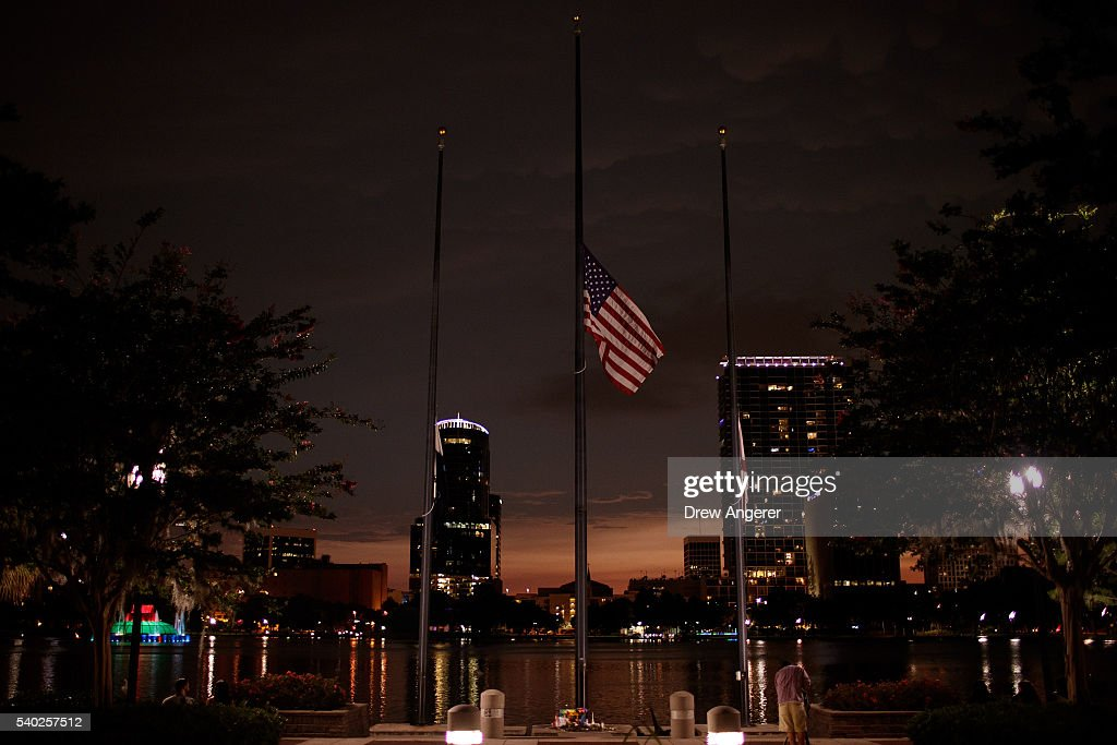 A flag flies at half mast for the victims of the Pulse Nightclub shooting, at Lake Eola, June 14, 2016 in Orlando, Florida. The shooting at Pulse Nightclub, which killed 49 people and injured 53, is the worst mass-shooting event in American history.