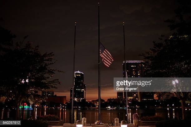 A flag flies at half mast for the victims of the Pulse Nightclub shooting at Lake Eola June 14 2016 in Orlando Florida The shooting at Pulse...