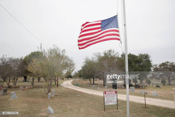 A flag flies at half mast outside the Sutherland Springs Cemetery on November 10 2017 in Sutherland Springs Texas Tomorrow the first victimis of the...