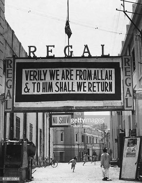 Flag flies at half-mast over the main notice board of the Regal cinema in Lahore, Pakistan, while the country mourns the death of Mohammad Ali...
